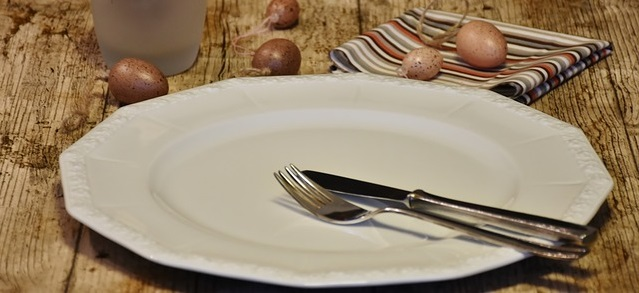 Empty plate on a wooden table