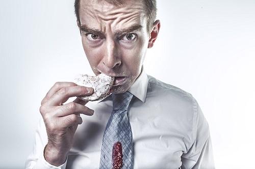 man eating cookie