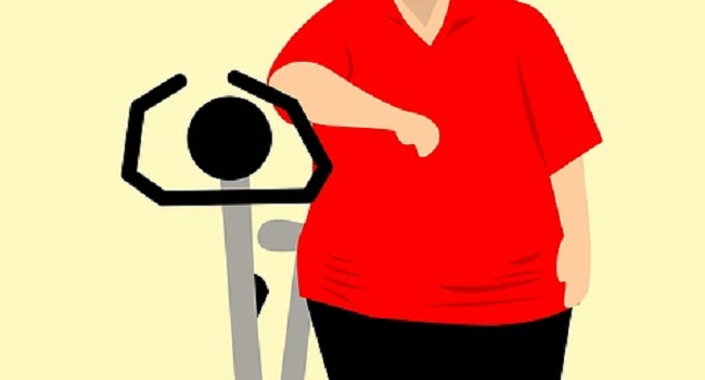 overweight man with stationary bike