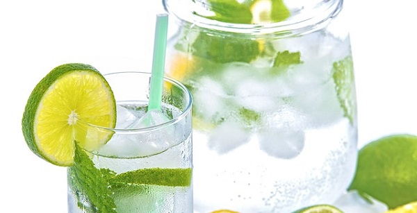 water in glass with lemon