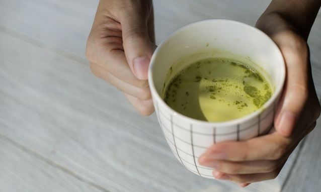 Person holding a cup of Matcha.