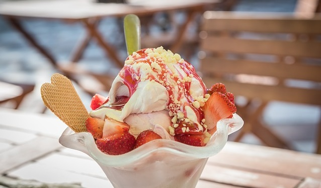 Ice cream sundae on a table outside.