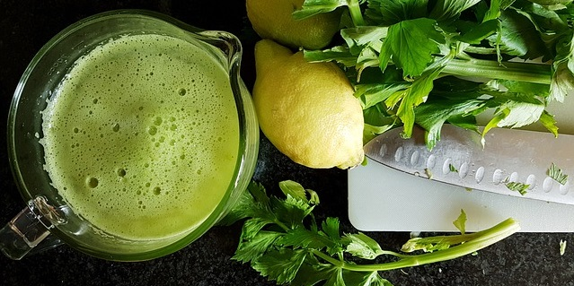Green smoothie with lemon and leafy greens.