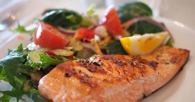 Salmon and vegetables on a plate.