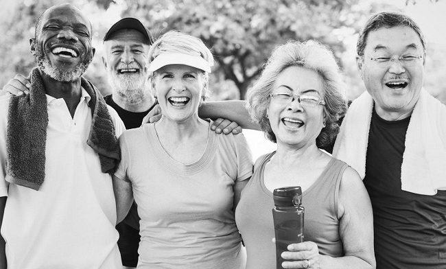 Smiling men and women wearing sports gear.