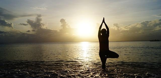 Yoga on the beach at sunrise.